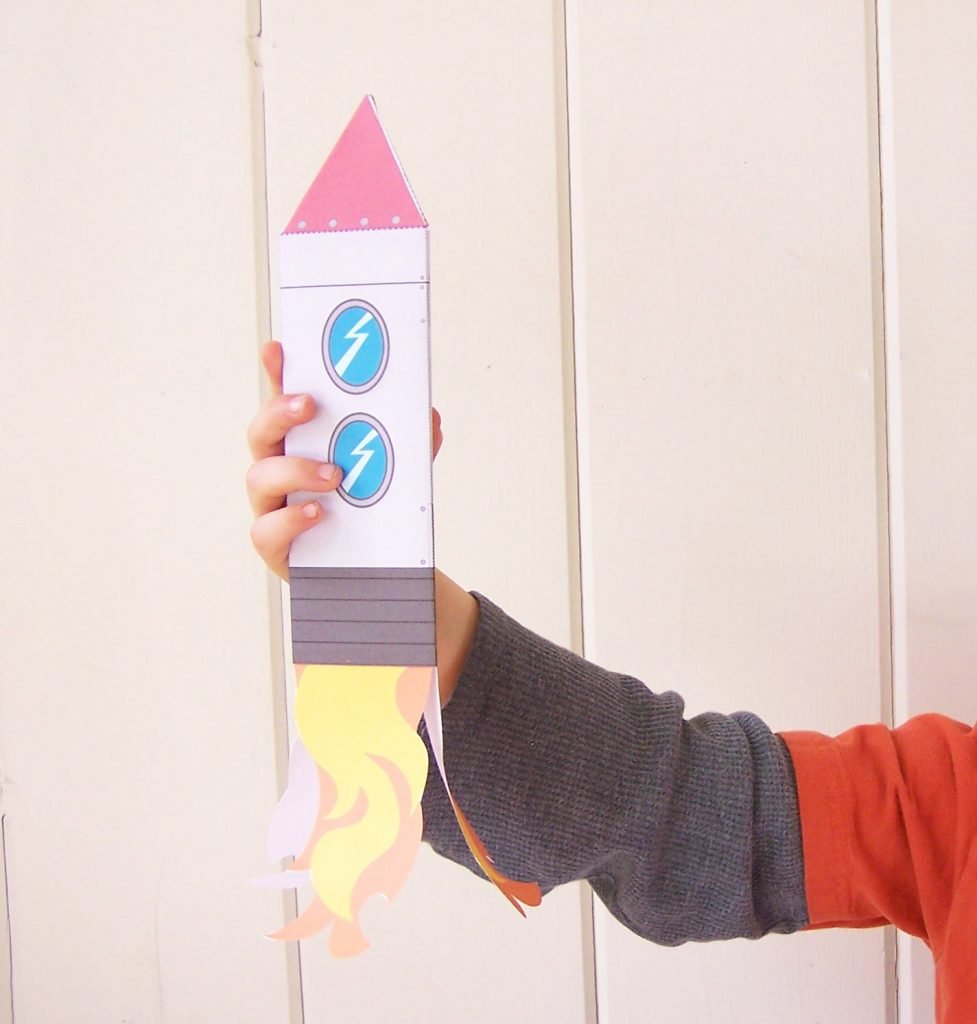 How fun is this printable rocketship craft toy? Includes a PDF download of the colored craft plus black & white version to print and play. It's an easy papercraft for kids!