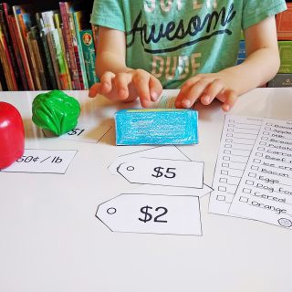 Free Grocery Store Pretend Play Printables - Includes a papercraft card reader, debit card, grocery lists, and price tags.